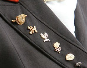 Anky van Grunsven's lapel. Olympic pins of the triple Olympic champion