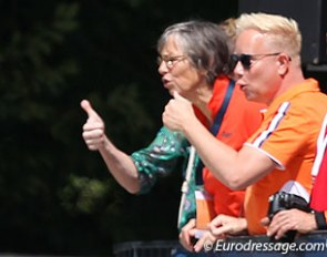 Trainer Tineke Bartels and Maarten van der Heijden, the Dutch federation's technical director for dressage, give Madeleine Witte-Vrees thumbs' up