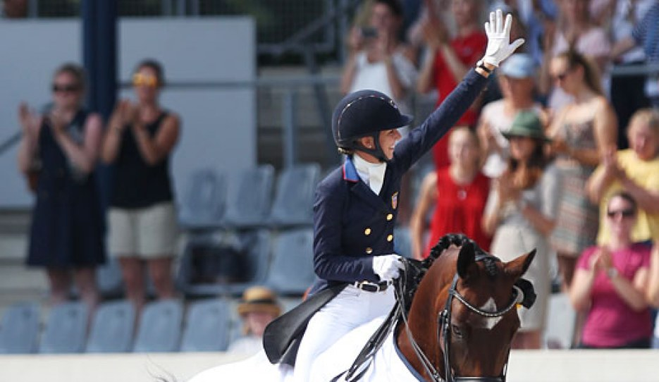 Laura Graves waves to the crowds after winning the 5* Grand Prix at the 2018 CDIO Aachen :: Photo © Astrid Appels