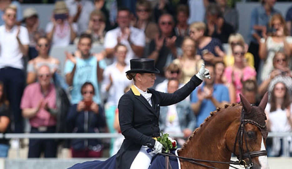 Isabell Werth puts her thumb up to crowd in the prize giving ceremony at the 2019 CDIO Aachen :: Photo © Astrid Appels