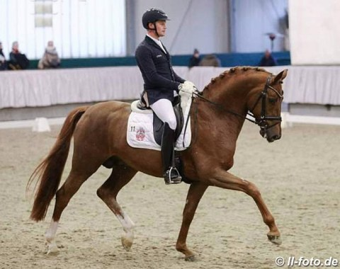 Matthias Rath on his stepmom Ann Kathrin Linsenhoff's Hanoverian Destacado