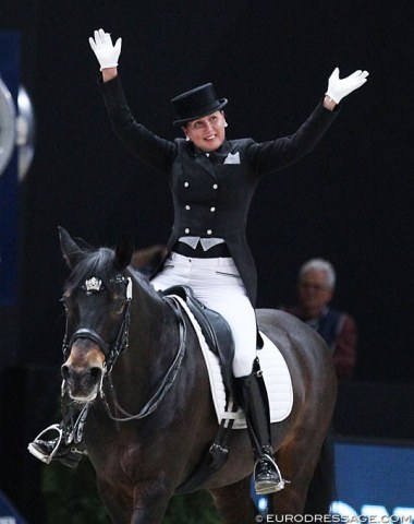 Inessa Merkulova waves to the crowds after she finishes her test on Mister X