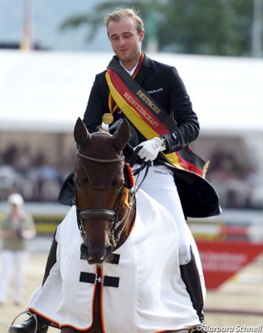Sönke Rothenberger in his lap of honour on loaner horse, Anabel Balkenhol's Divinia La Douce