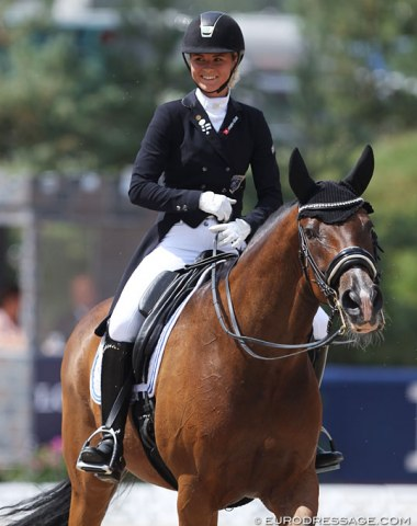 Finnish Janni Martikainen on the Belgian warmblood Cornando van de Cadzandhoeve. Big smile for her 69.029% score.