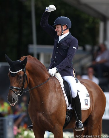 Matthias Rath raises his fist as he wins silver on Destacado at his first World Young Horse Championships