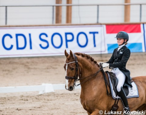 Ida Persson and Tago with the CDI Sopot banner in the background