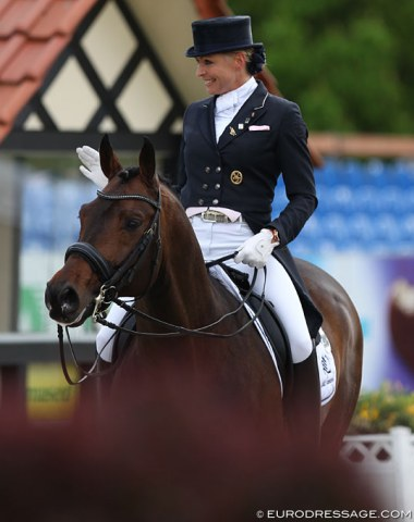 Anja Plönzke waves to the crowds as she leaves the arena with Fahrenheit
