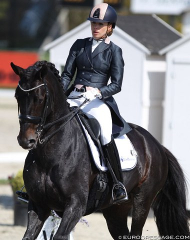 Lynne Maas on the 10-year old KWPN bred Eastpoint (by Westpoint x Negro). The stallion was very distracted and spooky on the short side at C but Maas kept her cool