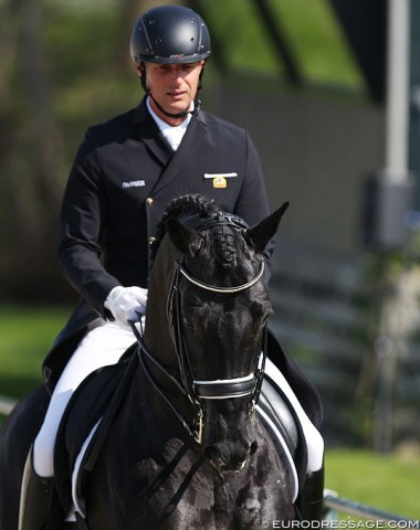 Patrick van der Meer on the Kruininger family owned KWPN stallion Chinook (by Vivaldi). The gorgeous black is 12-year old but still needs more time to gain a better balance and self carriage in the piaffe and passage work. The extended canter was really uphill.
