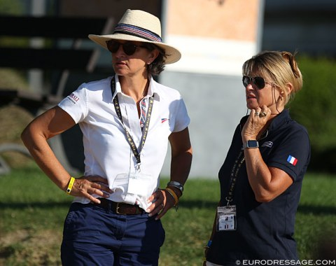 French Dressage Director Emmanuelle Schramm and French youth team captain Muriel Leonardi listen to the scores as the score board was not switched on today