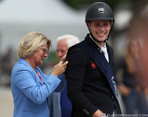 Frederic Wandres gets the Longines sash pinned on. This year there were no medals for the riders! The FEI remarkably changed the protocol to no medals at the request of the riders?? The award ceremony looked a bit lacklustre without gold, silver, bronze
