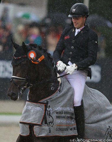 Frederic Wandres and Zucchero in the rainy prize giving
