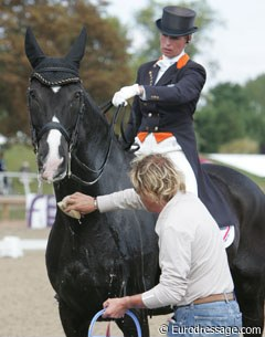 Helping hands: Sjef Janssen sponging Anky's Salinero before their Special test.
