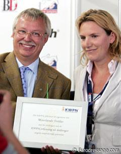 Cees Visser receiving the KWPN certificate that Totilas is approved for breeding based on his performance record