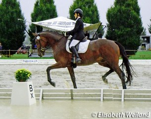 Esther Andres and Galetano brave the elements which turned the Avenches dressage ring into a pond on Saturday afternoon 17 September 2011