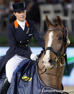 Adelinde Cornelissen rides Galahad in the prize giving for the Grand Prix at the 2011 CDI-W Mechelen. Galahad used to be named Molenkoning's Travers and is by Jazz x Blanc Rivage xx