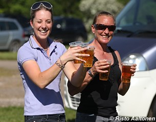 Charlotte Dujardin and Henriette Andersen carrying some refreshments