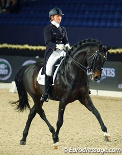 Joyce Heuitink on Wup (by Welt Hit II). The stallion has a very small piaffe and was unsteady in the contact, which led to an uneven passage and swinging tempi's, but the half passes were wonderful