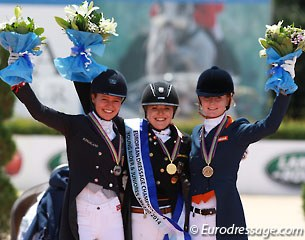 The individual test podium with Alexandra Andresen, Anna Christina Abbelen and Jeanine Nekeman at the 2014 European Junior Riders Championships in Arezzo, Italy :: Photo © Astrid Appels