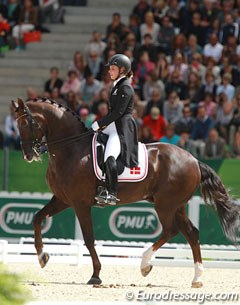 Danish Anna Kasprzak rode her Phil Collins' freestyle with Donnperignon who showed some of his best piaffe work ever. She lost some impulsion in the pirouettes and scope in the canter half passes
