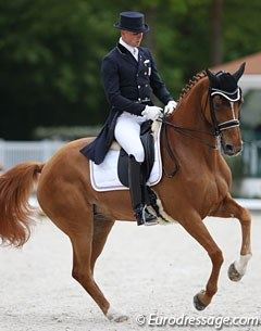 French Jean Philippe Siat and Marie-Christine Pointier's 10-year old Hanoverian mare Lovesong (by Locksley II x Wolkenstein II)