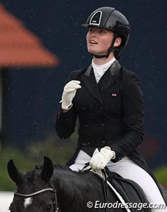 British Emily Bradshaw looks up at the rain she had to ride in