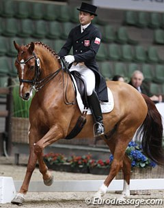 Poland's Rishat Sabitov on the Polish bred Azzaro. The gelding is very talented at Grand Prix but the piaffe is problematic and classically not correct with braking front legs and him leaning on the hindlegs (often seen with GP horses)