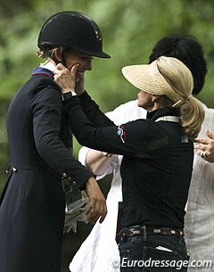 Trainer Debbie McDonald squeezes Laura Graves' cheeks after the prize giving ceremony