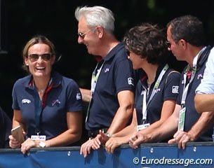 French team trainer Jan Bemelmans gives Arnaud Serre's wife Anne Sophie a pat on the back