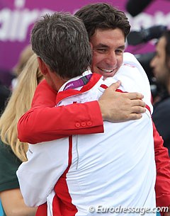 Steve Guerdat gets a big hug after winning gold