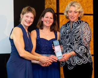 Jane Buchan handing Pippa Drew and Jo Filmer the Futurity 2-year old award for Hammerwood Flamingo at the 2019 British Breeders' Award Dinner