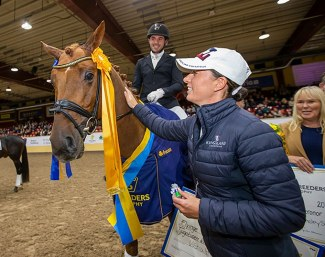 Charlotte Dujardin, test rider for 4-year olds, pats the winner Springbank II VH at the 2018 Swedish Warmblood Young Horse Championships