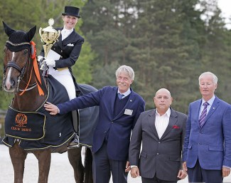 Kristy Oatley and Du Soleil in the prize giving with judge Thomas Lang, show host Arie Yom-Tov and legendary Hungarian dressage rider Gyula Dallos at the 2019 CDI-W Budapest :: Photo © Anett Samogyvari